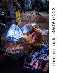 Small photo of Vietnam 2016 Jan 8,Woman hawker sold food in Da lad night-market ,Dalad,Vietnam.