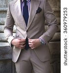 Man Buttoning Jacket