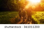 Stock photo group of friends walking with backpacks in sunset from back adventure travel tourism hike and 361011203