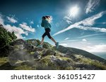 female running in mountains... | Shutterstock . vector #361051427