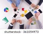 business team working in an... | Shutterstock . vector #361054973
