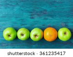 Green Apples And One Orange...