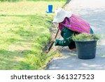 women gardener at work.... | Shutterstock . vector #361327523