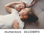 little sister hugging her... | Shutterstock . vector #361338893
