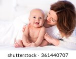 mother and child on a white bed.... | Shutterstock . vector #361440707