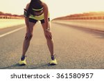 Tired Woman Runner Taking A...