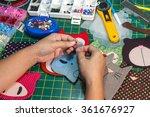 a woman is doing needlework... | Shutterstock . vector #361676927