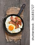 fried eggs with bacon in frying ... | Shutterstock . vector #361831727