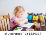 blonde kid painting with... | Shutterstock . vector #361834337