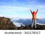 cheering young woman hiker open ... | Shutterstock . vector #362178317