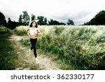 Young Woman Running Through Th...