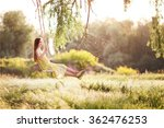 girl riding on a swing in forest | Shutterstock . vector #362476253