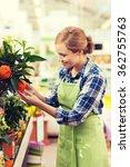 happy woman touching mandarin...   Shutterstock . vector #362755763