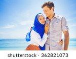 happy muslim couple on a beach | Shutterstock . vector #362821073