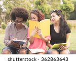 three students are studying at...   Shutterstock . vector #362863643