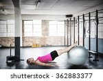 Woman Doing Pilates Against Gym