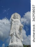 Small photo of THE GODDESS OF COMPASSION AND MERCY,blue sky and clouds background