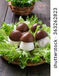Small photo of Original appetizer of stuffed eggs in the form of porcini on lettuce leaves. Selective focus
