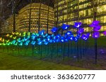 "Small photo of LONDON, UK - JANUARY 15, 2016: Winter Lights Festival at Canary Wharf, includes the installation ""On The Wings Of Freedom"" by Aether & Hemera featuring a cloud of butterflies in Jubilee Park"