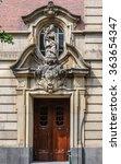 Old Wooden Door With Statue In...