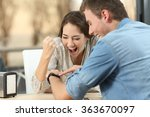 excited couple reading e mail... | Shutterstock . vector #363670097