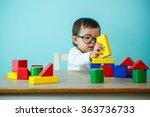 Kid Toddler Playing Wooden Toy...