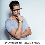 handsome young man with wrist... | Shutterstock . vector #363857507