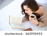 Cute Lovely Young Woman Readin...