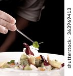 male chef garnishing his dish ... | Shutterstock . vector #363969413
