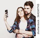 loving couple making selfie  | Shutterstock . vector #364269743