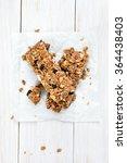 granola bars on paper over... | Shutterstock . vector #364438403