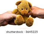 A teddy bear being given as a gift - stock photo
