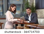 two young business people using ... | Shutterstock . vector #364714703