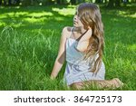 view of a young girl sitting on ... | Shutterstock . vector #364725173