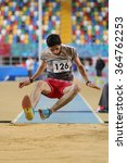 Small photo of ISTANBUL, TURKEY - DECEMBER 12, 2015: Athlete Ozkan Saridag long jumpes during Turkish Athletic Federation Olympic Threshold Indoor Competitions