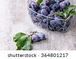 Ripe Purple Plums With Leaves...