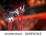 Burning Red Incense Sticks In...