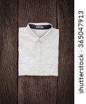 white shirt on wooden background | Shutterstock . vector #365047913