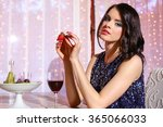 a young girl sitting at a table ... | Shutterstock . vector #365066033