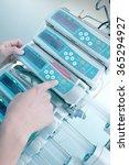doctor adjust equipment in... | Shutterstock . vector #365294927