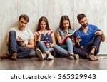 four attractive young friends... | Shutterstock . vector #365329943