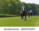 Stock photo several racehorses with jockeys during a horse race 365470247