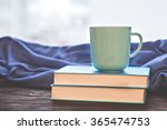 cup warm beverage on the pile... | Shutterstock . vector #365474753