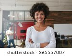 Smiling Young Woman Standing...