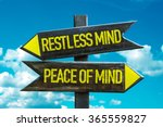 Small photo of Restless Mind - Peace of Mind signpost with sky background
