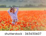 Girl At Blooming Poppy Field....