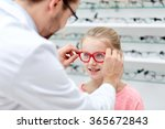 Optician Putting Glasses To...