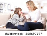 portrait of a beautiful mother... | Shutterstock . vector #365697197