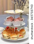 cakes and sandwiches at tiered... | Shutterstock . vector #365733743