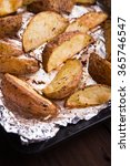 Small photo of Fried russet potato on tray with aluminium foil.